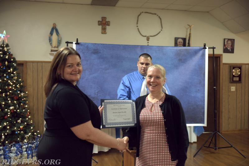 Rita Weaver accepting on behalf of the Ridge Lions Club