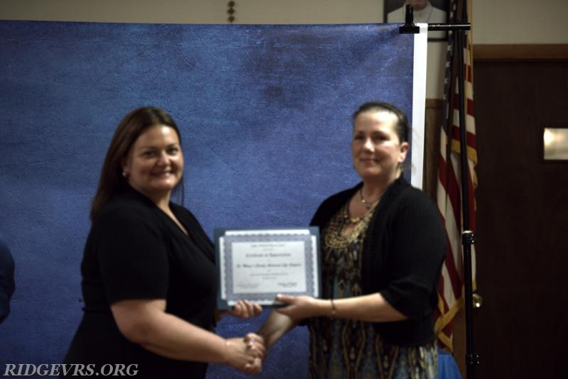 Associate member Debbie Hitchcock accepting the mutual aid certificate for SMALS.